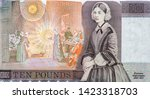 """Florence Nightingale Nurse (1820-1910). """"The Lady with the Lamp"""" hospital scene at Scutari (Uskudar; Chrysopolis). Portrait from Great Britain 10 Pounds 1975-1992 Banknotes. Collection."""
