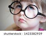 serious white child girl in big ... | Shutterstock . vector #1423382939