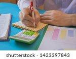 business man doing finances on... | Shutterstock . vector #1423397843