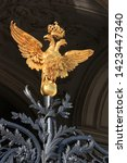 Double-headed eagle guarding the patterned wrought-iron gate of the Hermitage in St. Petersburg, Russia