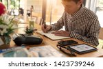focused young man figuring out... | Shutterstock . vector #1423739246