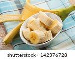 fresh organic banana in bowl ... | Shutterstock . vector #142376728