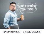 a mature man holding a computer ...   Shutterstock . vector #1423770656