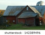 Red Barn And White Silo In...