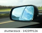 rear view on a car mirror... | Shutterstock . vector #142399126
