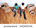 overhead view of couple sitting ... | Shutterstock . vector #142403146