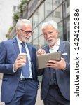 two senior gray haired... | Shutterstock . vector #1424125886