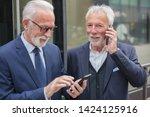 two happy senior businessmen... | Shutterstock . vector #1424125916