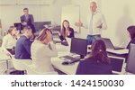 Small photo of Irritated honcho scolding subordinates, pointing out shortcomings and misses in work