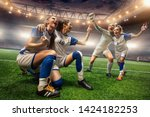 Happy female soccer players on...