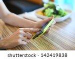 female using mobile phone on...   Shutterstock . vector #142419838