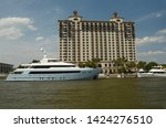 luxury yachts are docked at a... | Shutterstock . vector #1424276510