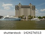 luxury yachts are docked at a... | Shutterstock . vector #1424276513