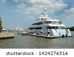 luxury yachts are docked at a... | Shutterstock . vector #1424276516