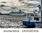 ferries waiting to take... | Shutterstock . vector #1424282426
