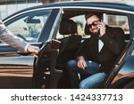 busy smiling businessman in... | Shutterstock . vector #1424337713