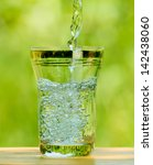 pouring water into a glass... | Shutterstock . vector #142438060