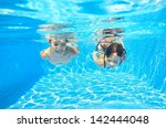 Happy Girls Swim Underwater In...