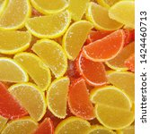 Small photo of Macro photo food dessert jelly sweets. Texture background lemon and orange jelly sweets
