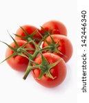 fresh wet tomatoes on vine... | Shutterstock . vector #142446340