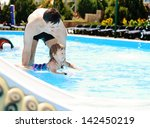 lessons of swimming from father ... | Shutterstock . vector #142450219
