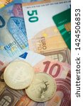 golden bitcoins with euro notes ... | Shutterstock . vector #1424506853