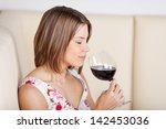 beautiful woman enjoying a... | Shutterstock . vector #142453036