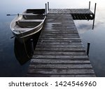 a boat tied to a dock. | Shutterstock . vector #1424546960