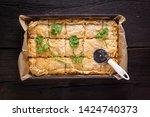 fresh australian meat pie with... | Shutterstock . vector #1424740373