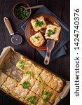 fresh australian meat pie with... | Shutterstock . vector #1424740376
