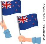new zealand flag in hand.... | Shutterstock .eps vector #1424749979