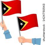 east timor flag in hand.... | Shutterstock .eps vector #1424750543