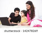 father and mother using laptop... | Shutterstock . vector #142478269