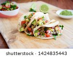 Small photo of Pulled pork tacos with salsa, guacamole and lime, with copy space