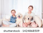 smiling sisters sitting with...   Shutterstock . vector #1424868509