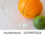 green juicy lime and orange. on ...   Shutterstock . vector #1424907626