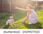 positive cheerful woman playing ...   Shutterstock . vector #1424927423
