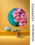 Small photo of Mid autumn festival moon cake and tea set on coloured background still life image.