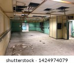 Small photo of Disused office space abandoned hastily after asbestos discovery during lighting works.