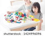 asian baby and her mother play...   Shutterstock . vector #1424996096