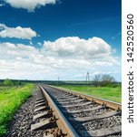 railroad closeup to horizon and blue sky - stock photo