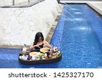 table poolside asian woman with ...   Shutterstock . vector #1425327170
