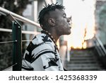 smoking guy. young african man... | Shutterstock . vector #1425368339
