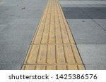 tactile paving on footpath for... | Shutterstock . vector #1425386576
