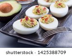 deviled eggs stuffed with...   Shutterstock . vector #1425388709