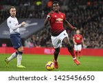 Small photo of LONDON, ENGLAND - JANUARY 13, 2019: Christian Eriksen of Tottenham and Paul Pogba of Manchester pictured during the 2018/19 Premier League game between Tottenham Hotspur and Manchester United.