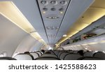 passengers traveling by a plane.... | Shutterstock . vector #1425588623