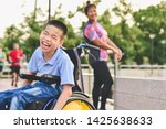 Disabled child on wheelchair is ...