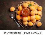glass jar of apricot jam with... | Shutterstock . vector #1425669176
