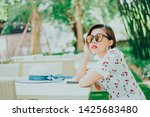 portrait of young asian smiling ... | Shutterstock . vector #1425683480